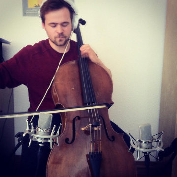 @henryandthewaiter recording cello with Neumann Microphones